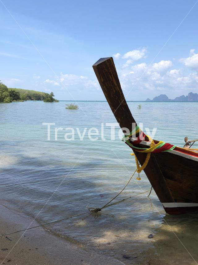Long-tail boat at the beach on Koh Mook Island in Thailand