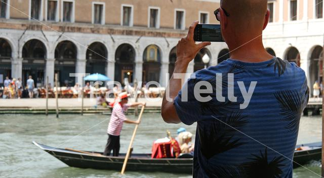 Man makes a photo with his mobile in Venice Italy