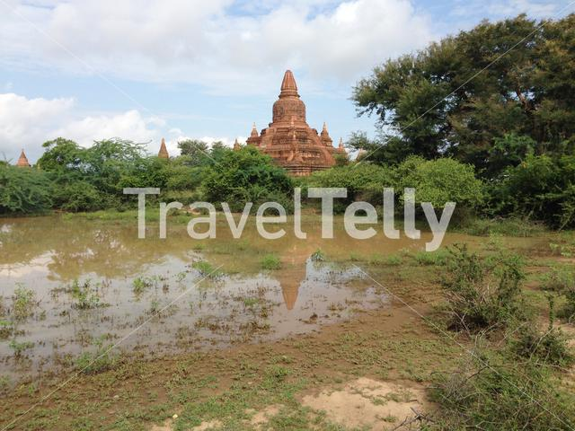 The buledi pagoda with reflection in a pond in Bagan Myanmar