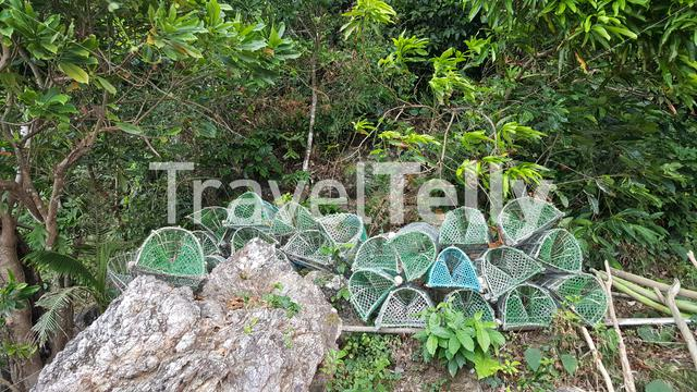 Fish nets drying on rocks in TayTay, Philippines