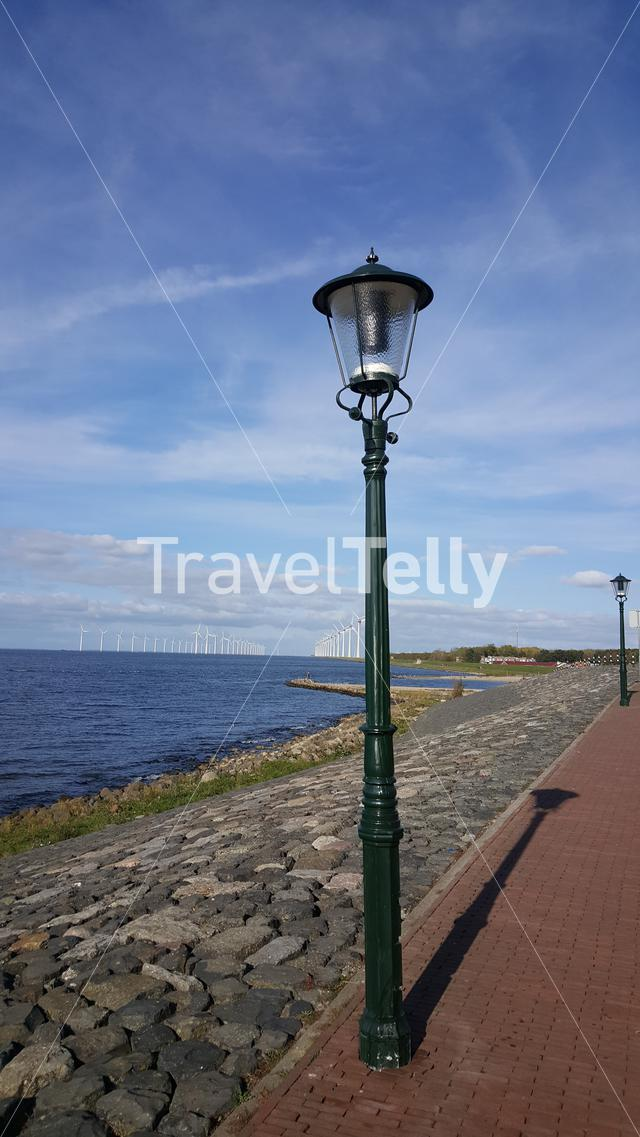 View over Dutch Ijsselmeer lake with electricity windmills