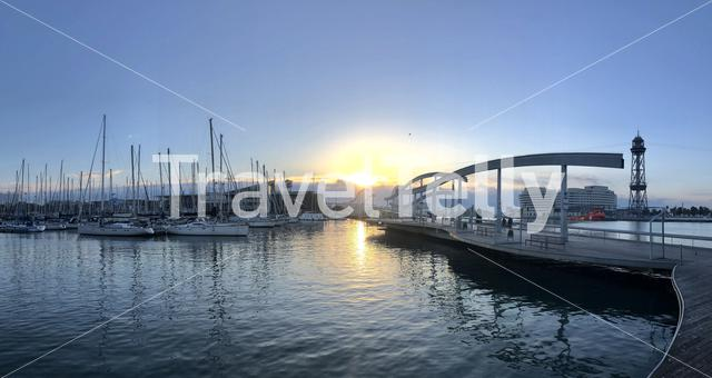Sunrise in the harbor of Barcelona in Spain