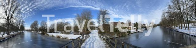 Panorama from a bridge over a frozen canal in Sneek in Friesland The Netherlands