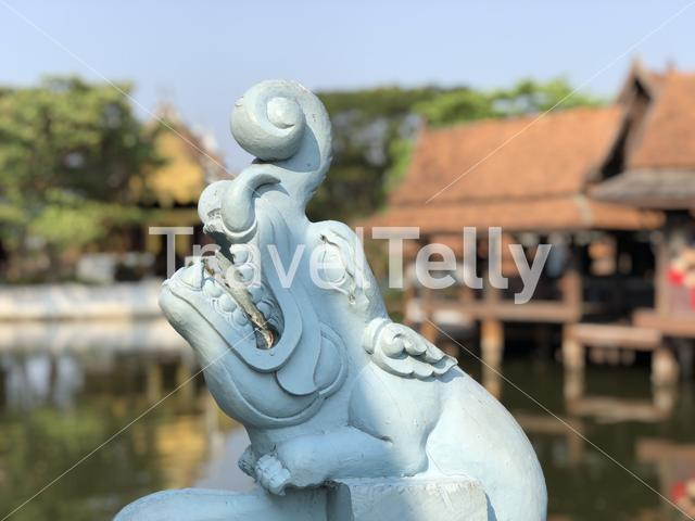 Wood statue at the floating market in the Ancient Siam, Thailand