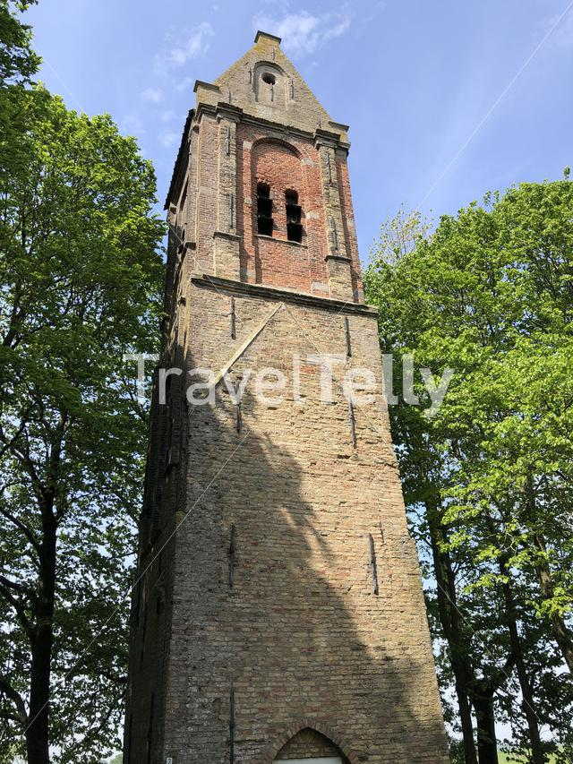Church tower and 2th world war memorial and cemetery around Mantgum in Friesland The Netherlands