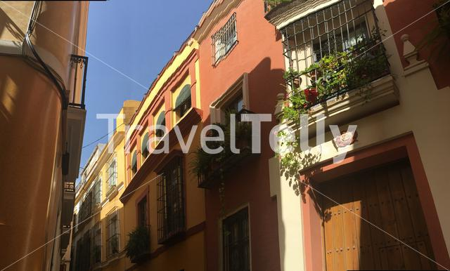 Panorama from a narrow street in the old town of Seville Spain