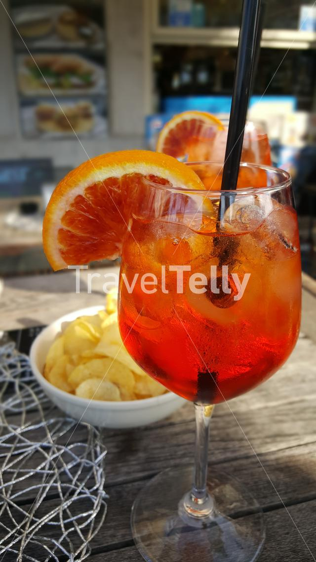 Glasses with tasty Aperol spritz on terrace