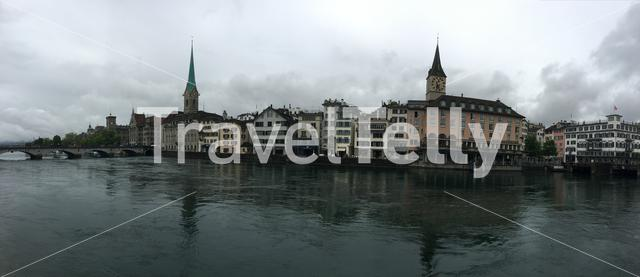 Panorama from the Limmat river with the St. Peter and Fraumünster Church in Zurich Switzerland