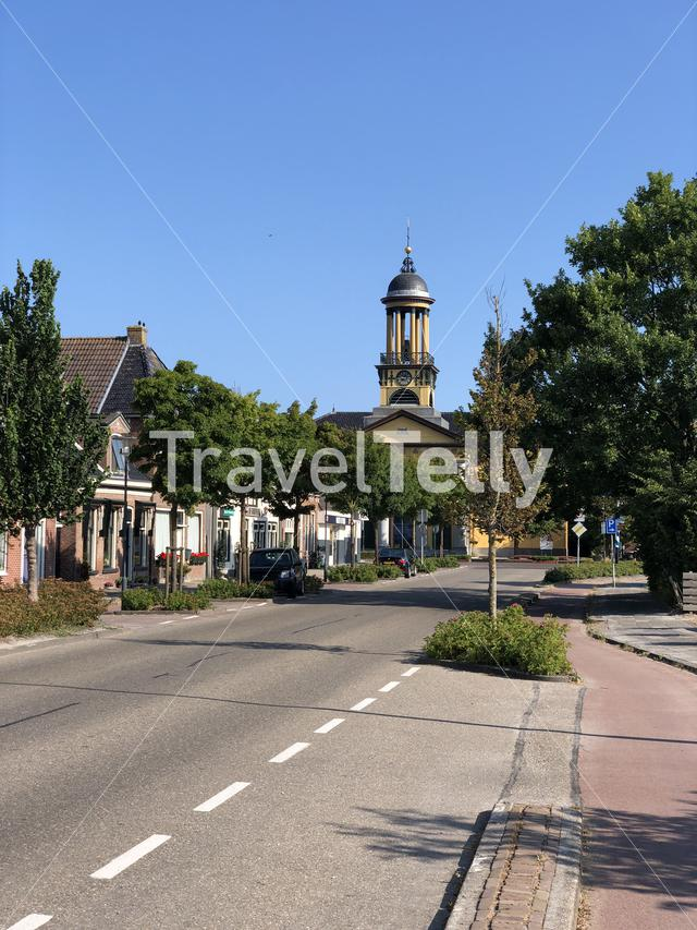 Street towards the the big church in Sint Jacobiparochie, Friesland The Netherlands