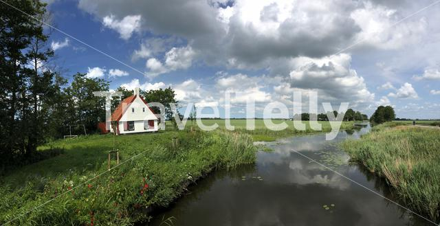 Panorama from canal in Friesland, The Netherlands
