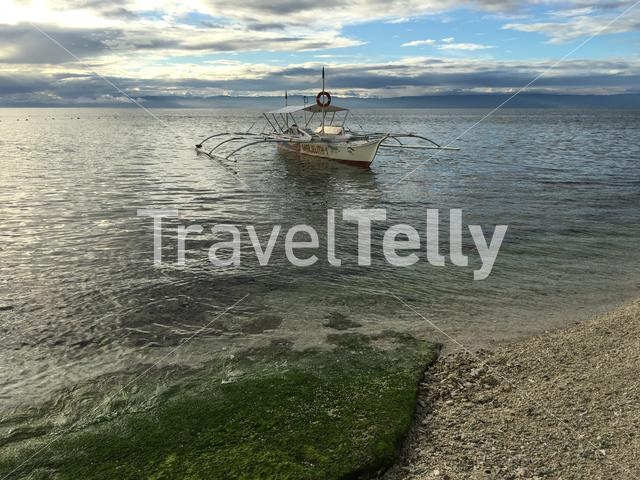 Catamaran Boat in the water during low tide at Balicasag Island in Bohol the Philippines