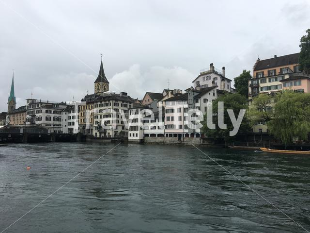 The Limmat river with the St. Peter and Fraumünster Church in Zurich Switzerland