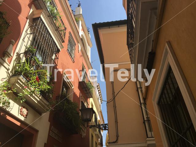 A narrow street in the old town of Seville Spain