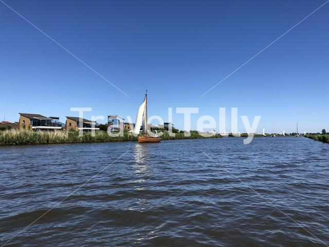 Sailing on a canal near Heeg in Friesland The Netherlands