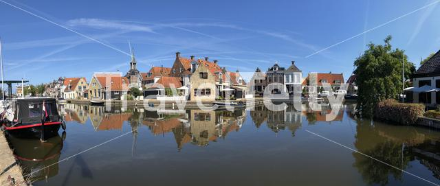 Panorama from houses next to a canal in the old town of Makkum, Friesland, The Netherlands