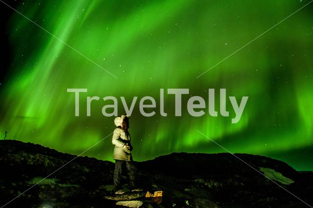Looking up to the northern light in Kulusuk Greenland