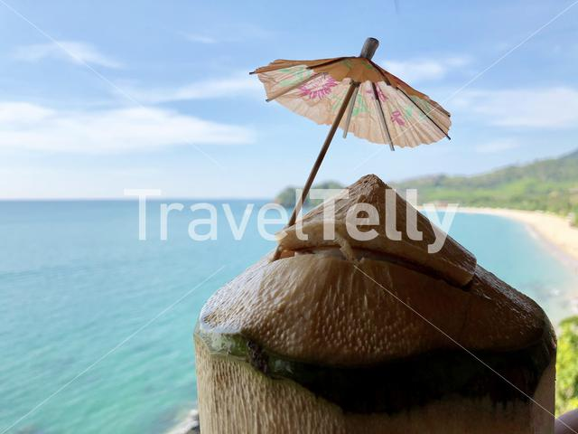 Coconut with a small parasol in Koh Lanta Thailand