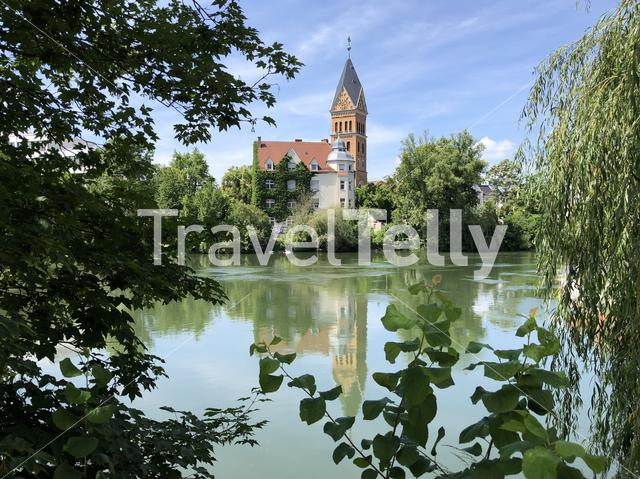 Isar river and the Christuskirche in Landshut Germany