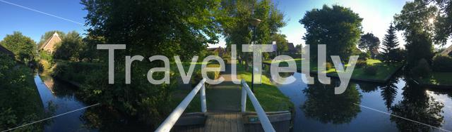 Panorama from a bridge over a canal in Giethoorn The Netherlands