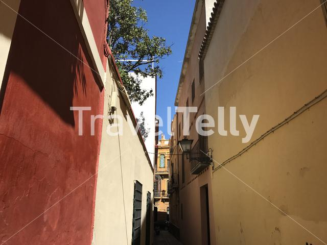 Walking through the narrow streets of Seville Spain