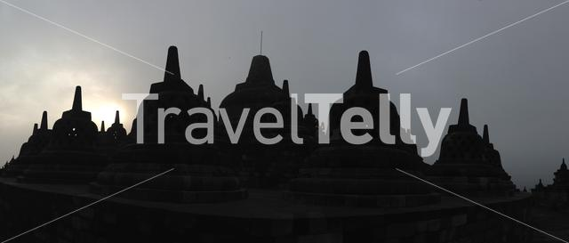 Panorama from sunrise at the Borobudur Temple a 9th-century Mahayana Buddhist temple in Magelang, Central Java, Indonesia