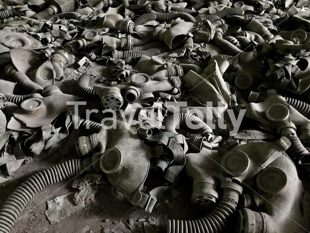 Gas masks on the ground in a school at Pripyat a ghost town in northern Ukraine