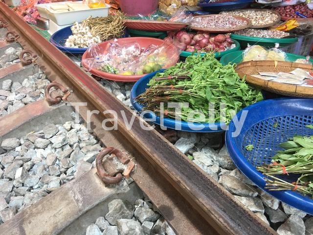 Food at the Maeklong Railway Market (Talad Rom Hoop) in Samut Songkhram, Thailand