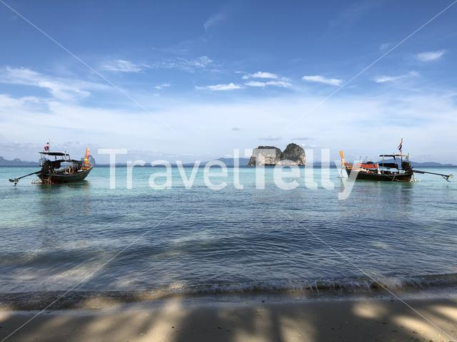 Long-tail boats close to the beach of Koh Ngai in Thailand