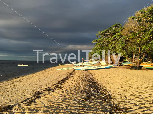 Catamaran boats on the beach during sunsetat Balicasag Island in Bohol the Philippines