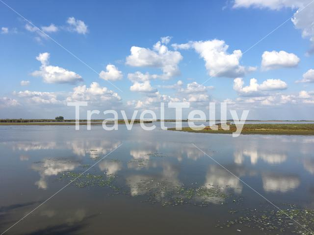 Clouds reflection in a lake at Hortobagy National Park Hungary