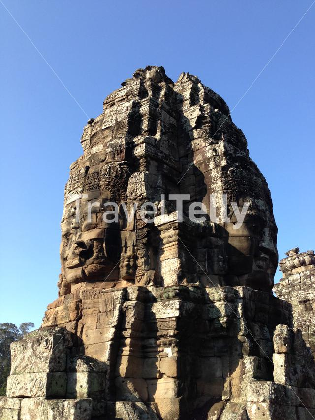 Smiling faces carved into stone walls of Bayon Temple in Krong Siem Reap, Cambodia