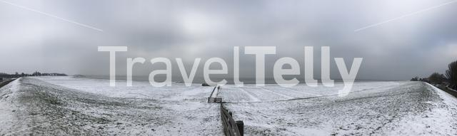Panorama from a dike with snow in Hindeloopen The Netherlands