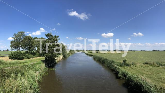 Canal towards Wommels in Friesland, The Netherlands