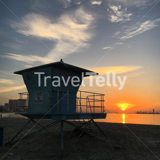 Sunset at the beach with lifeguard tower. Eyespiration photo walk, mindfulness moment in travel blogging.