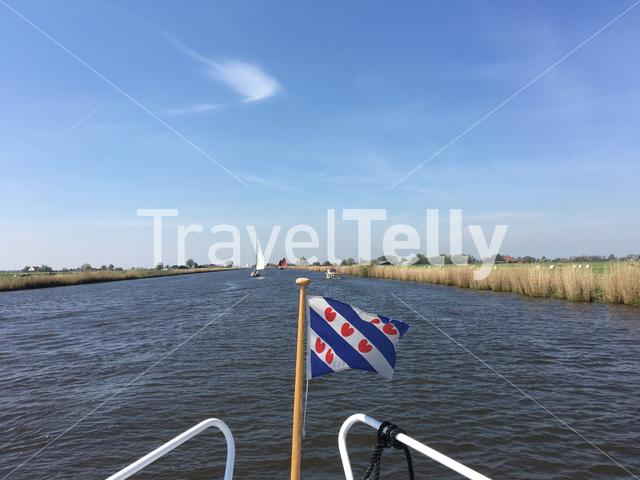 Frisian flag at a boat in the Jeltesleat in Friesland The Netherlands