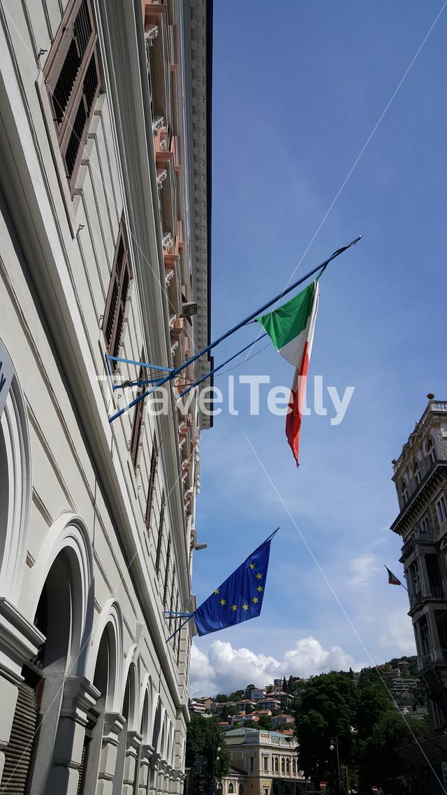 Italian and European flags on building