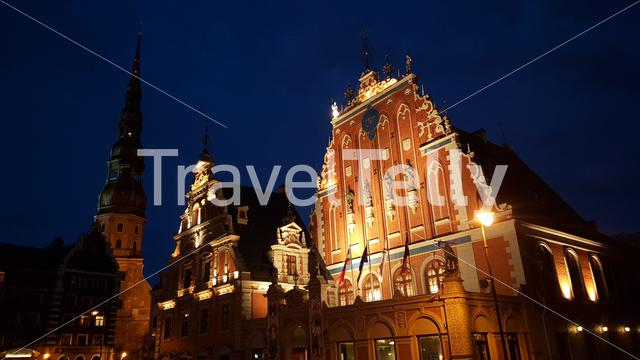 House of the Blackheads and the St. Peter's Church at night in Riga Latvia