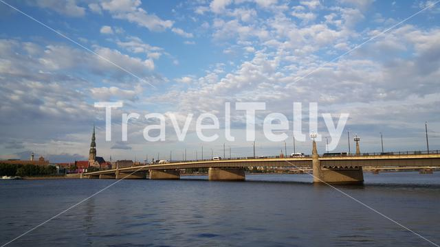 The stone Bridge and Daugava river with the St. Peter's Church at the background in Riga Latvia