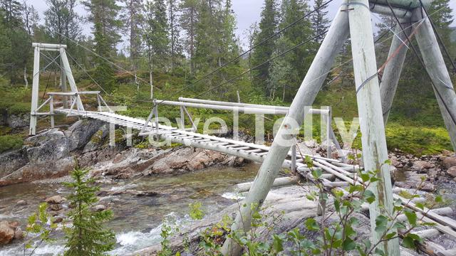 A wooden bridge over a river in Borgefjell National Park Norway