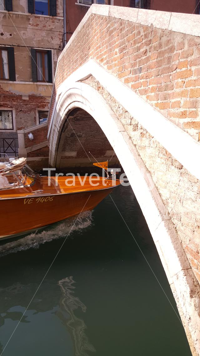 Boat passing by at bridge in Venice