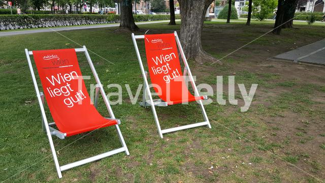 Red chairs in park Vienna