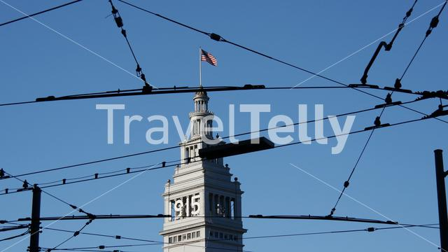San Francisco Ferry Building with bus and tram wires