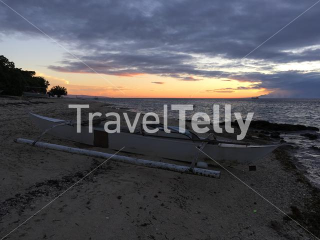 Catamaran Boat at the beach during sunset of Balicasag Island in Bohol the Philippines