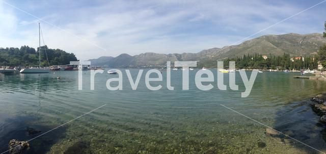 Panorama from cavtat harbour with boats and in the background mountains in Croatia