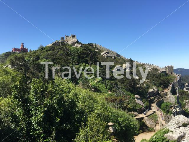 Castelo dos Mouros with the Pena Palace at the background in Sintra Portugal