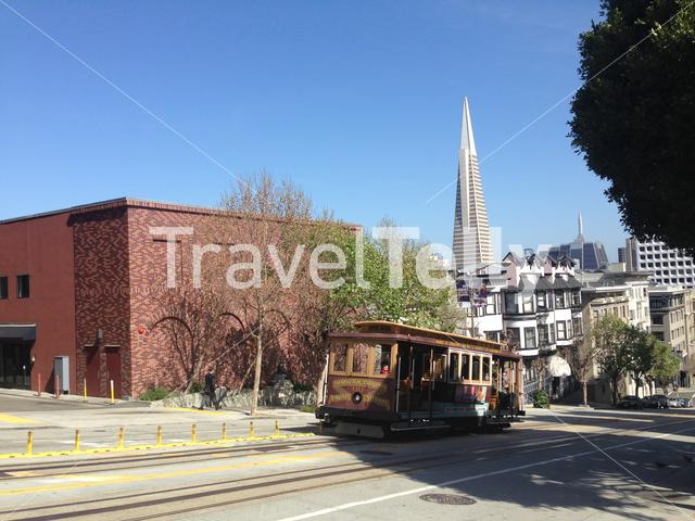 Cable car with Transamerica Pyramid at the background in San Francisco