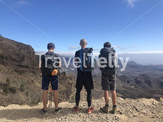Three hiking friends enjoying the view during a hike on Gran Canaria