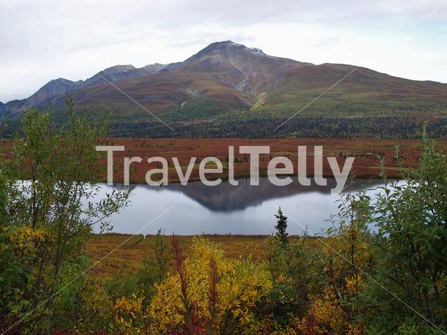 Lake with lazy mountain at the background in Alaska