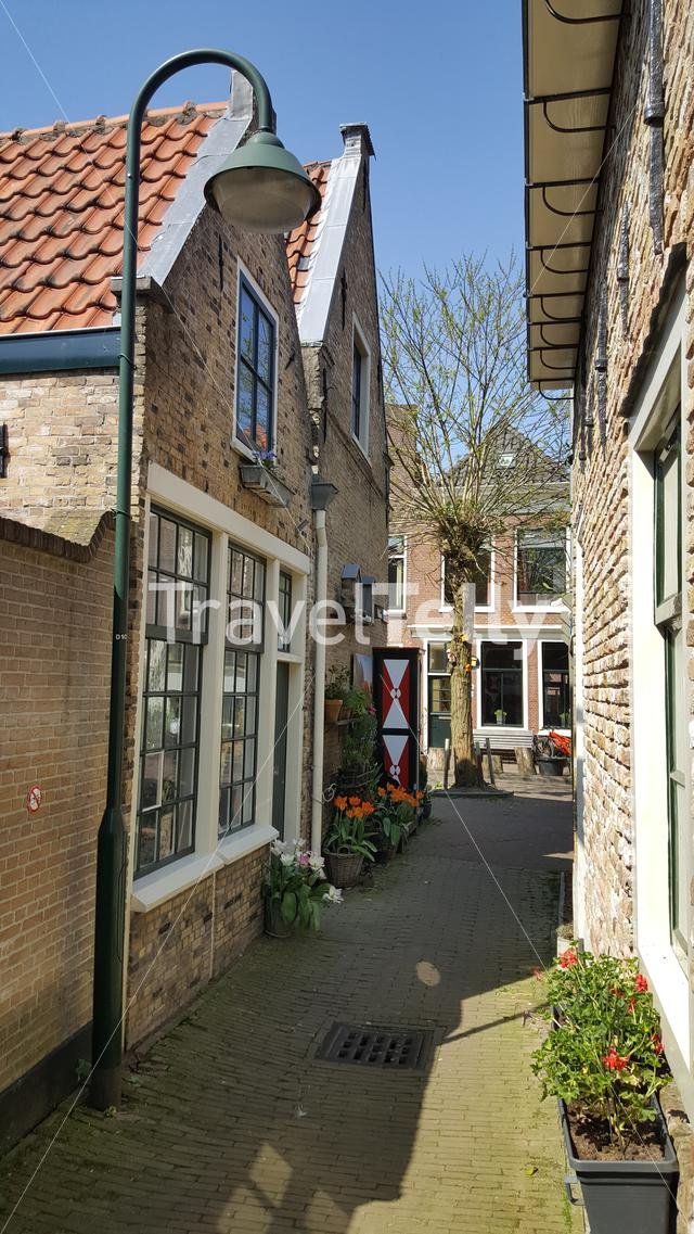 Small walkway street in City of Gouda, The Netherlands