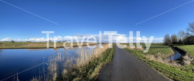 Panorama from road next to a canal on a winter day around Akkrum in Friesland The Netherlands